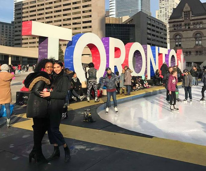 Karema Batotele and Jurice Encarnacion melting the ice at Nathan Philips Square before they went on a tour of Toronto's trendiest shopping areas