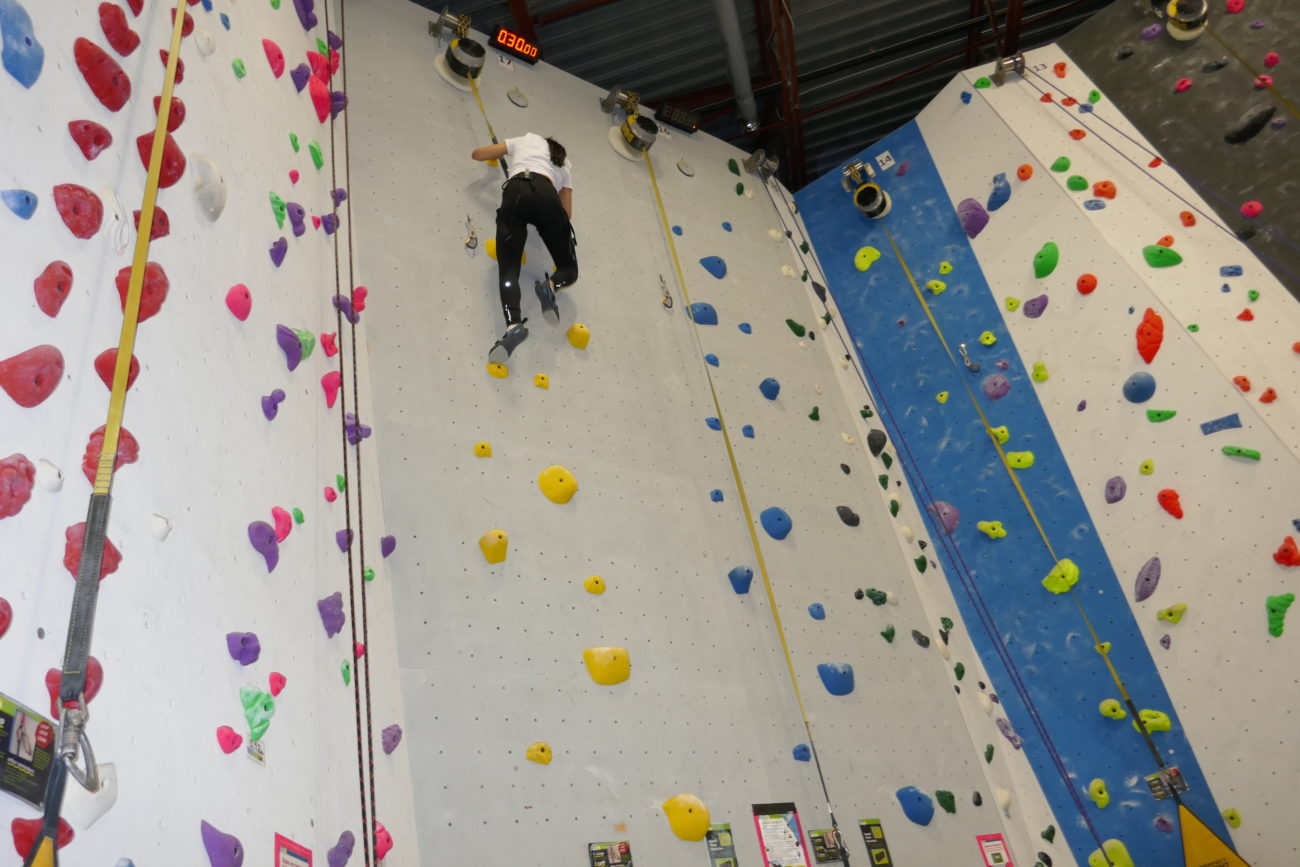 the speed climb to stop the clock atop the wall at Hub Climbing in Markham