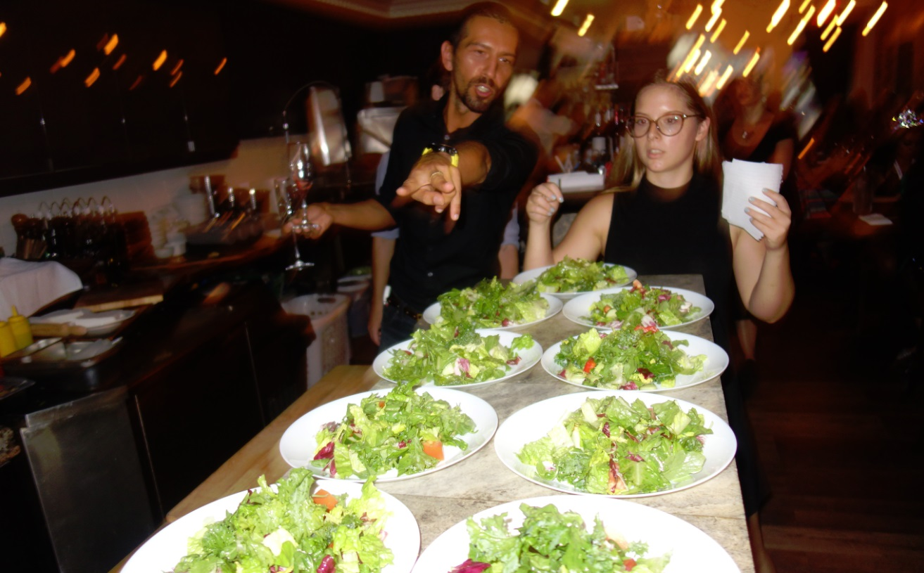 a rush of salads in Pizza e Pazzi restuarant kitchen